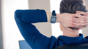 Rear view of businessman wearing smartwatch Stock Photo