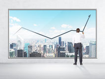 Rear view of businessman who is drawing a line chart on the New York panoramic poster. Stock Photography