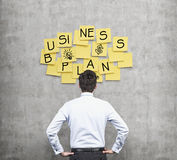 Rear view of the businessman who thinks about new business plan. Stock Image