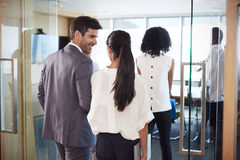 Rear View Of Businesspeople Entering Boardroom For Meeting Royalty Free Stock Photos