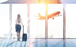 Rear view of businesswoman in airport Stock Photography
