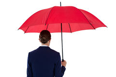 Rear view of businesswoman holding red umbrella Stock Image