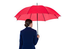 Rear view of businesswoman holding red umbrella Stock Images