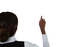 Rear view of businesswoman touching invisible screen Royalty Free Stock Photography