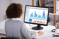 Businesswoman Working On Graph On Computer royalty free stock image