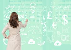 Rear view of businesswoman writing business concept on green board Royalty Free Stock Photography