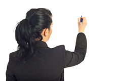 Rear view of businesswoman writing on copy Stock Image