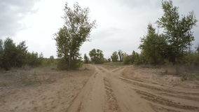 Rear view of car driving along a rural dirt road stock video footage