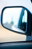 Rear view car mirror blurred object warning Stock Images