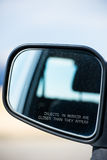 Rear view car mirror object warning Stock Photo