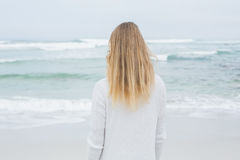 Rear view of a casual blond at beach Stock Photo