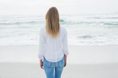 Rear view of a casual blond at beach Stock Photography