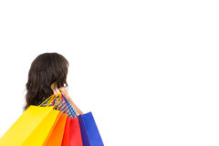 Rear view of a casual woman holding shopping bags Stock Image