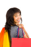 Rear view of a casual woman holding shopping bags Royalty Free Stock Image