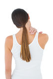 Rear view of a casual woman suffering from neck ache Royalty Free Stock Photo