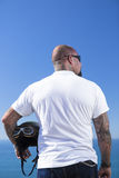 Rear view of a chopper motorbiker standing Royalty Free Stock Photos
