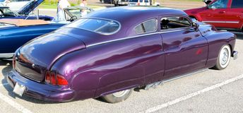 Rear View of Classic American Antique Car in Plum Crazy Purple Royalty Free Stock Image