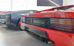 Rear view of classic red Ferrari sports car. Rear view of two ferrari testarossa sports cars, one blue, one red, in london, europe Royalty Free Stock Photo
