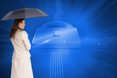 Rear view of classy businesswoman holding umbrella Royalty Free Stock Image