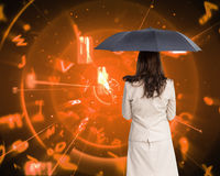 Rear view of classy businesswoman holding umbrella Royalty Free Stock Photography
