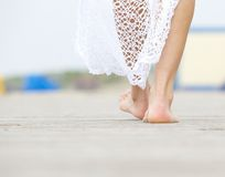 Rear view close up female walking barefoot Stock Photo