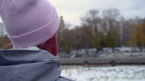 Rear view close-up of hipster woman with backpack in hat. Young beautiful woman with pink hair and pink hat on autumn stock photography