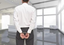 Rear view of corrupt businessman in hand cuffs Royalty Free Stock Image