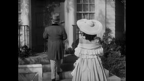 Rear view of couple entering house