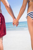 Rear view of couple holding hands at the beach Royalty Free Stock Images