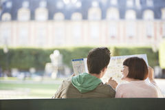 Rear View Of Couple Looking At Map In Park Stock Photography