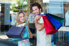 Rear view of couple with shopping bags Royalty Free Stock Photography