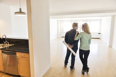 Rear View Of Couple Standing In New House Royalty Free Stock Images