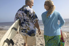 Rear View Of A Couple With Surf Boards On Beach Royalty Free Stock Image