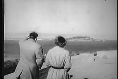 Rear view of couple walking along waterfront, San Francisco, California, stock footage