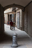 Rear view of a couple walking on narrow street Royalty Free Stock Photo