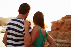 Rear View Of Couple Watching Sunset Over Harbour Royalty Free Stock Photo