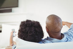 Rear view of couple watching television Stock Photos