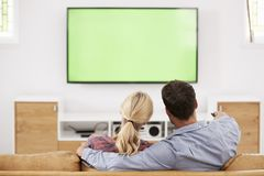 Rear View Of Couple Watching Television Together royalty free stock photos