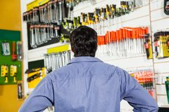 Rear View Of Customer In Hardware Shop Stock Photo