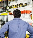 Rear View Of Customer Standing In Hardware Shop Stock Images