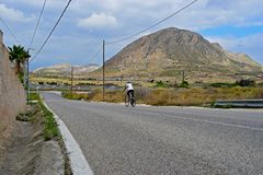 Rear View Of a Cyclist In The Mountains With Stunning Scenery Stock Image