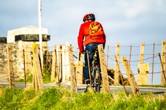 Rear view of a cyclist riding on the streets in Wales stock photo