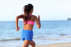 Rear View Of Determined Woman Jogging On Beach Royalty Free Stock Image
