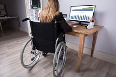 Disabled Businesswoman Working On Computer stock photos