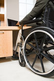 Rear view of a disabled man in a wheelchair Royalty Free Stock Photos