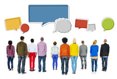 Rear View of Diverse People and Empty Speech Bubbles Royalty Free Stock Photos