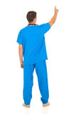 Rear view doctor pointing Royalty Free Stock Photos