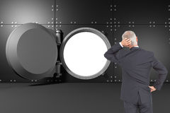 Rear view of doubtful mature businessman Royalty Free Stock Photography