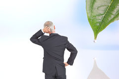 Rear view of doubtful mature businessman Stock Image