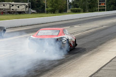 Rear view of drag car in action Royalty Free Stock Photos